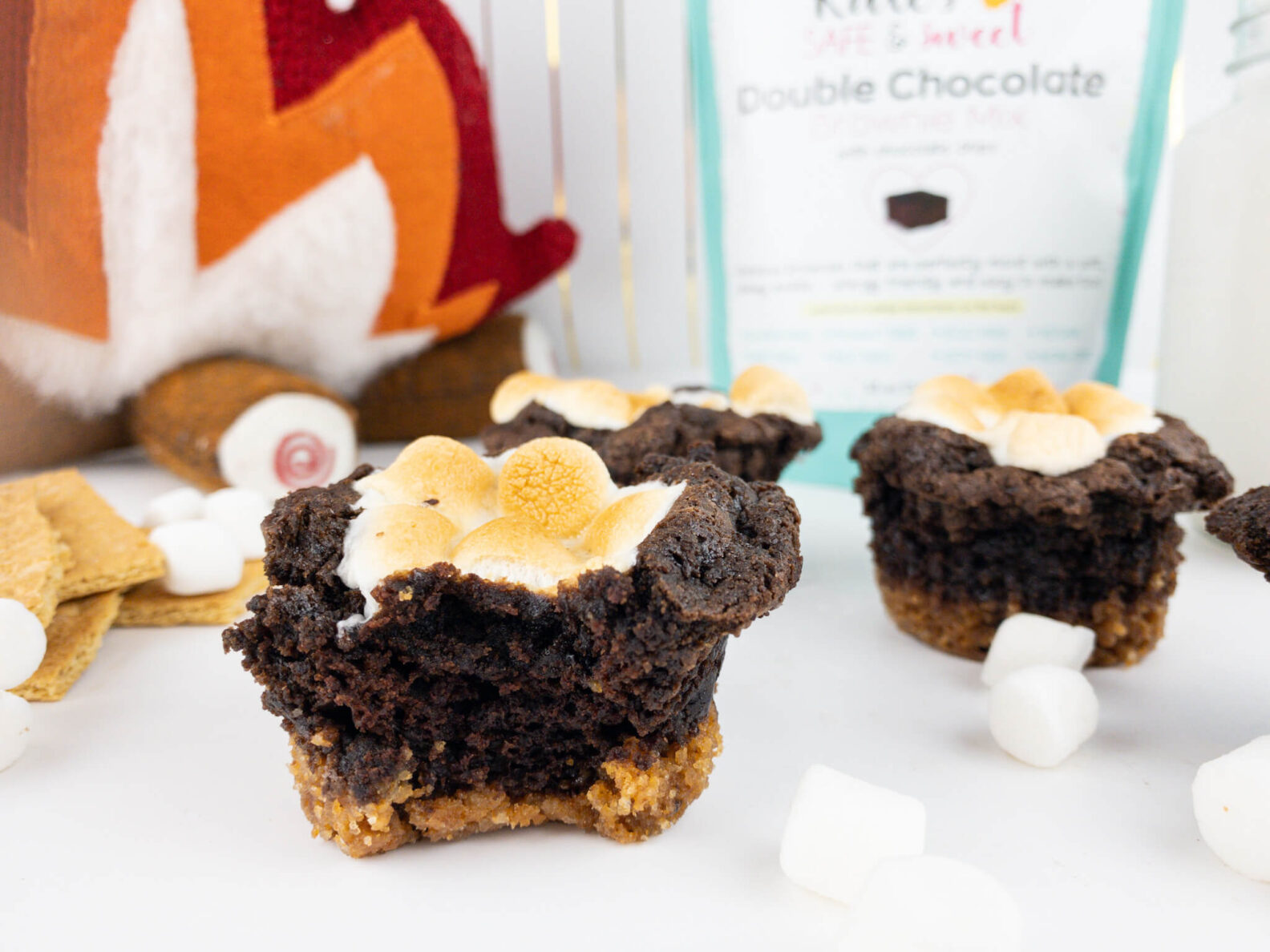 Kate's Safe and Sweet - Smores Brownie Cupcakes - Bite plus two