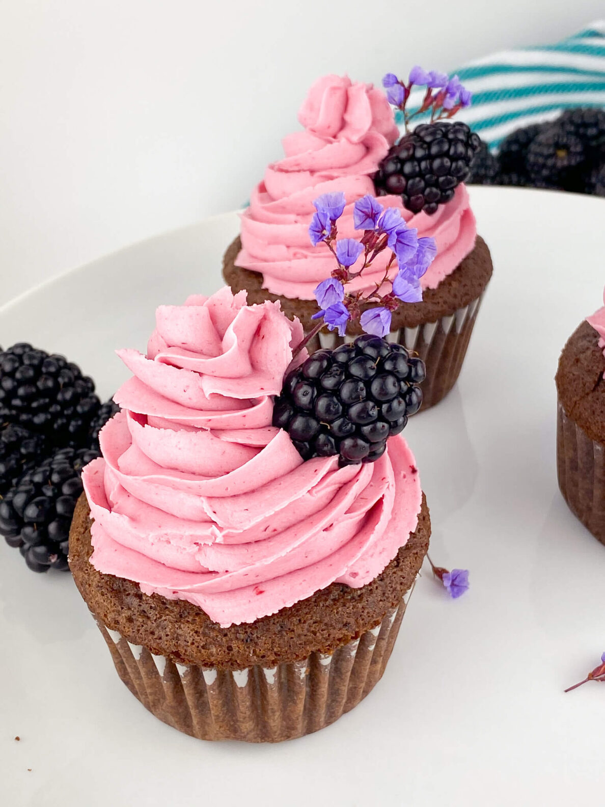 Kate's Safe and Sweet - Blackberry Frosted Chocolate Cupcakes on Plate